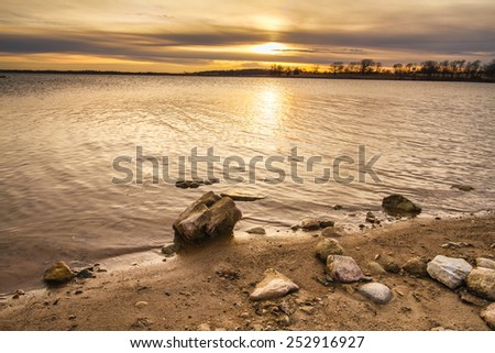 Smithville Lake towards dusk as the sun was going down.  Smithville Lake is located just outside of the Kansas City, Missouri and provides a lot of recreation use. - stock photo