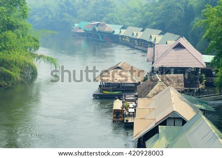 Smog of wild fire at Floating hotel houses on Kwai river. Kanchanaburi, Thailand - stock photo