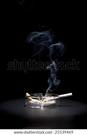 smoke and cigarettes in ash-tray - stock photo