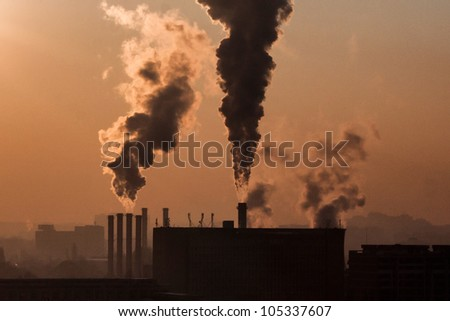 Smoke emission from factory pipes, daily at may window, a contamination of the ozone - stock photo