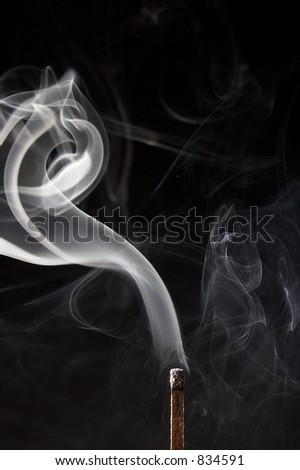 Smoke from a match that was just put out - stock photo