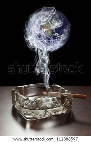 Smoke from cigarette polluting atmosphere. Elements of this image furnished by NASA. - stock photo
