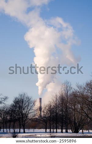 Smoke from factory pipes on a background of the clear pure sky - stock photo