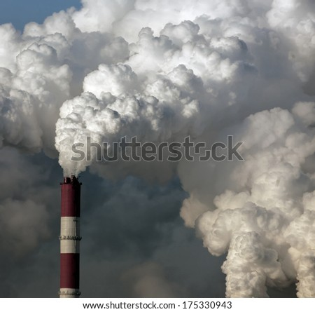 Smoke from the pipes of heat station - Moscow - stock photo