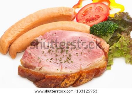 smoke ham steak with smoked sausage on the white plate - stock photo