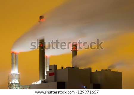Smoke originating from a large power-station - stock photo
