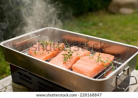 Smoke the salmon - stock photo