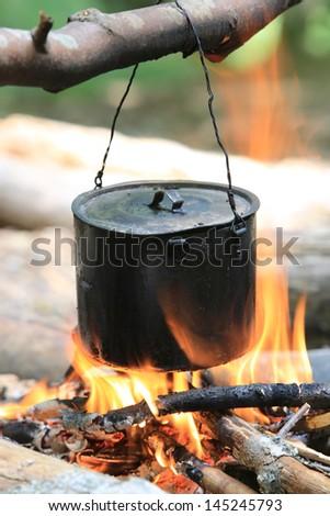 smoke tourist kettle on fire - stock photo
