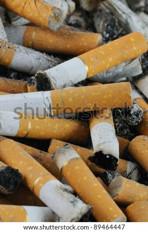Smoked cigarettes Part of an ashtray with butts of cigarettes - stock photo