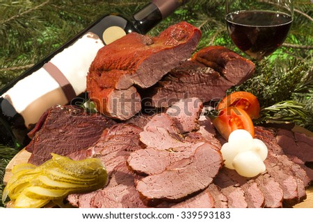 Smoked Deers Rump with wine and vegetable - stock photo