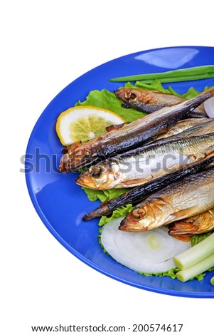 Smoked fish and salad on a blue plate isolated on white background - stock photo