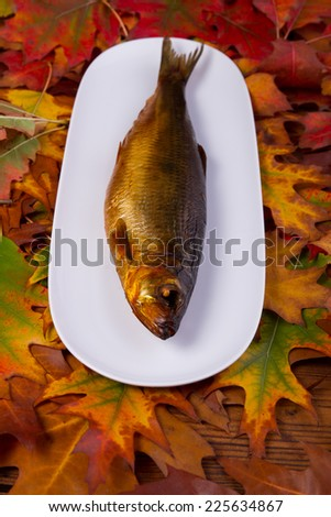 smoked fish on a plate - stock photo