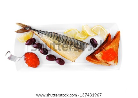 smoked fish served on plate with red caviar - stock photo
