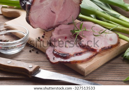 smoked ham on wooden background - stock photo