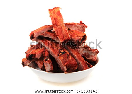 smoked pig ribs isolated on the white background - stock photo