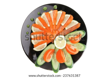 smoked salmon and vegetables served on plate - stock photo