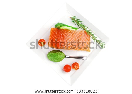 smoked salmon fillet isolated on plate with sauce - stock photo