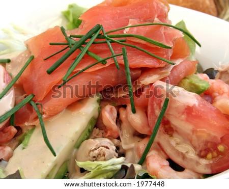 Smoked salmon salad with tuna and prawns - stock photo