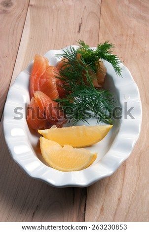 Smoked Salmon with lemon and Dill - stock photo