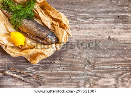 Smoked salmon with lemon on rustic wooden table, top view, copyspace, cocking background - stock photo
