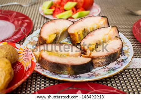 Smoked sturgeon fillets on a plate - stock photo