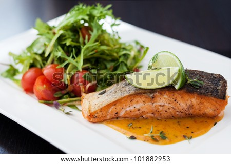 Smoked trout with vegetables and laim - stock photo