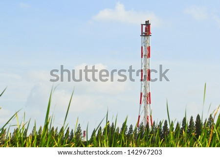 Smokestack burning flare in the petrochemical industry - stock photo