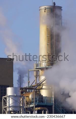 Smokestack of a factory in Zaragoza, Aragon, Spain - stock photo