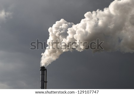 Smokestack Pollution with dark cloud in the background - stock photo