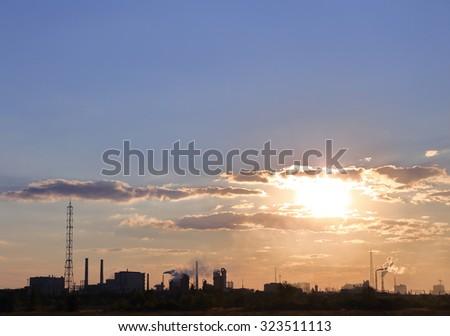 smokestacks sunset.  - stock photo