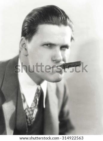 Smoking a cigar with attitude - stock photo