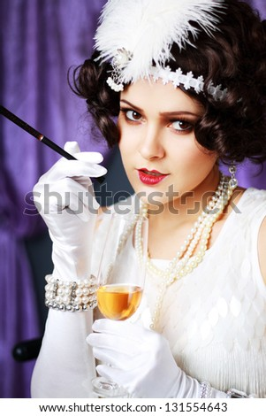 smoking and drinking flapper lady from 1920s - stock photo