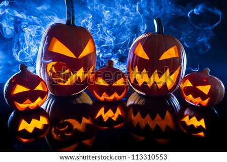 Smoking group Halloween pumpkins - stock photo