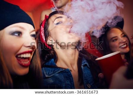 Smoking in bar - stock photo