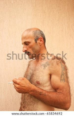 Smoking man vertical picture. - stock photo