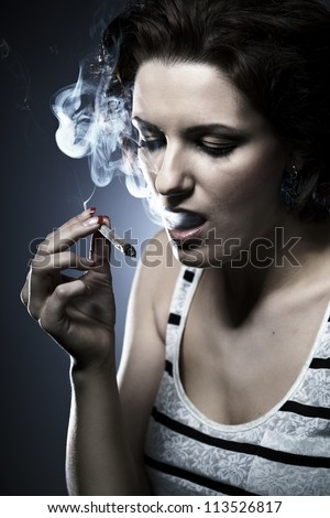 Smoking marijuana - stock photo