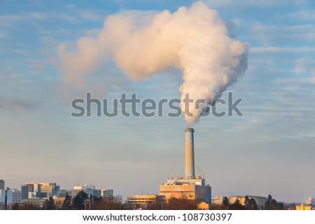 Smoking pipe of power plant - stock photo