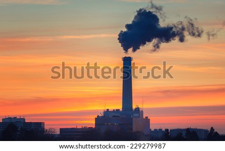 Smoking pipe of power plant - stock photo