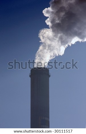 smoking pipe on blue sky - stock photo