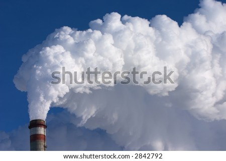 smoking pipes of factory, contaminating an environment on a background clean sky - stock photo