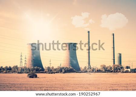 Smoking powerplant chimneys in the sun - stock photo