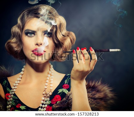 Smoking Retro Woman Portrait. Beauty Girl with Mouthpiece. Vintage Styled Beautiful Lady with cigarette. Hairstyle and Make up - stock photo
