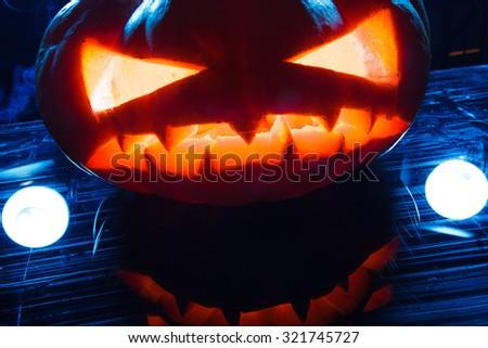 Smoking scary halloween pumpkin head. studio shot - stock photo