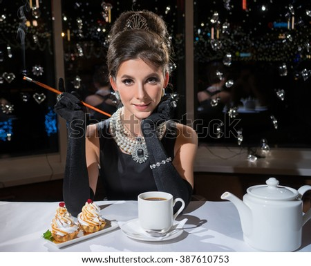 Smoking Woman in a restaurant, drink tea and eat cake - stock photo