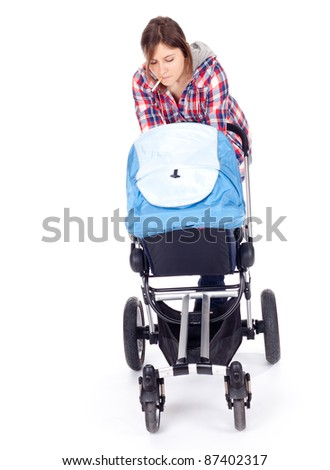 smoking young mother with baby buggy (stroller) - stock photo