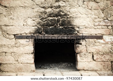 Smoky antique brick oven outdoor with ashes inside - stock photo