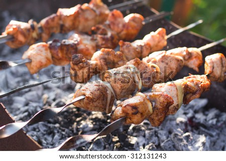 Smoky grilled marinated meat skewers Chicken. Close up - stock photo