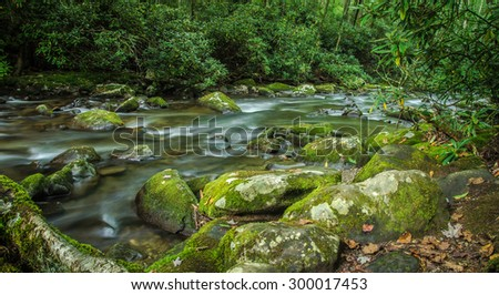 Smoky Mountain Stream. A river flows through the pristine beauty of the Great Smoky Mountains National Park. Gatlinburg, Tennessee. - stock photo