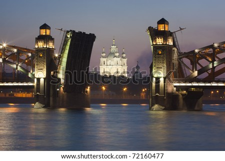 Smolny cathedral through open drawbridge. Bolsheohtinskiy bridge, St.Petersburg, Russia. - stock photo