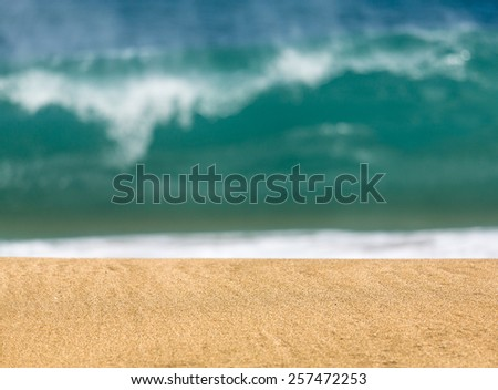 Smooth and sandy beach leading into the distance with waves - stock photo